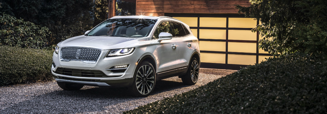 front and side view of white 2019 lincoln mkc