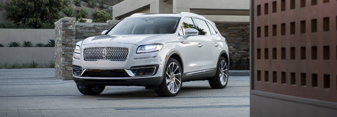 front and side view of white 2019 lincoln nautilus with new grille