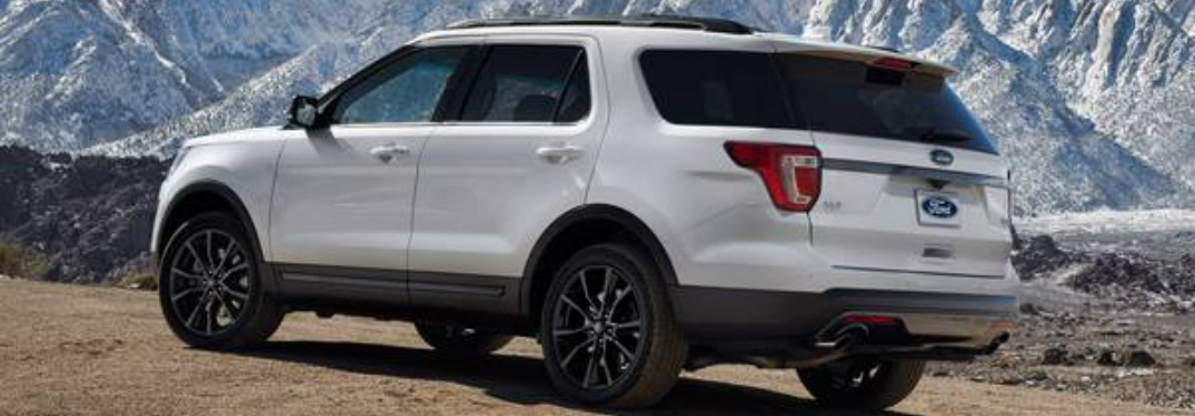 rear and side view of white 2019 ford explorer