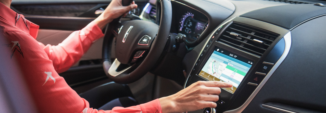 woman in 2019 lincoln mkc using infotainment system touchscreen