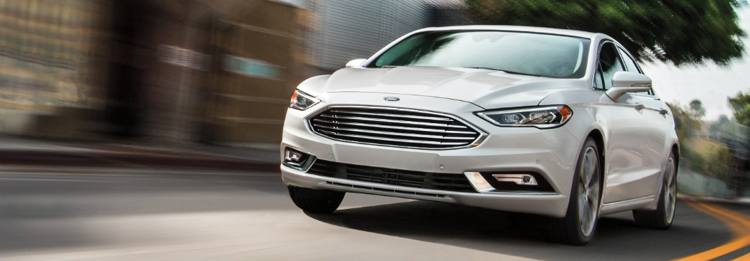 front and side view of white 2019 ford fusion hybrid