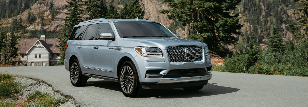 front and side view of silver 2019 lincoln navigator