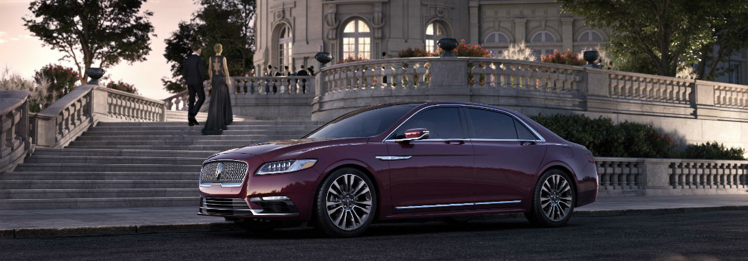 front and side view of red 2019 lincoln continental