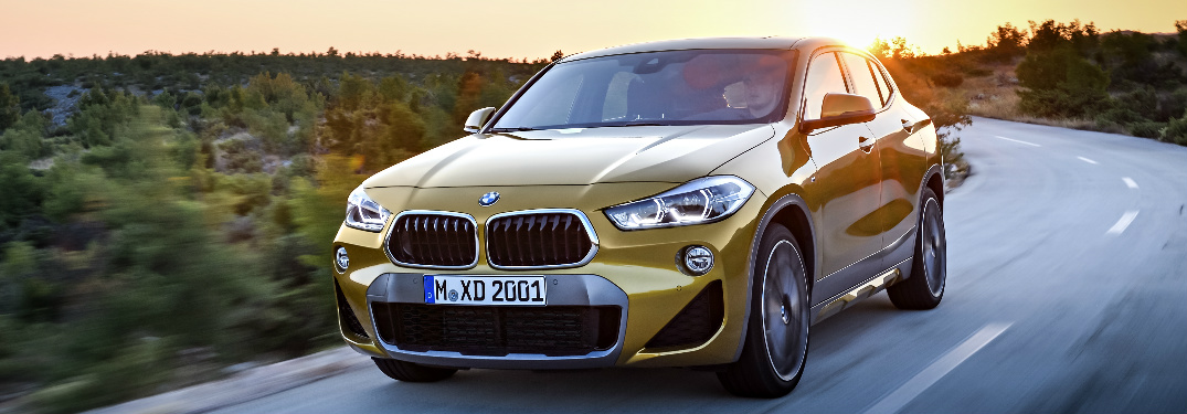 Yellow 2018 BMW X2 with the Sunset in the Background