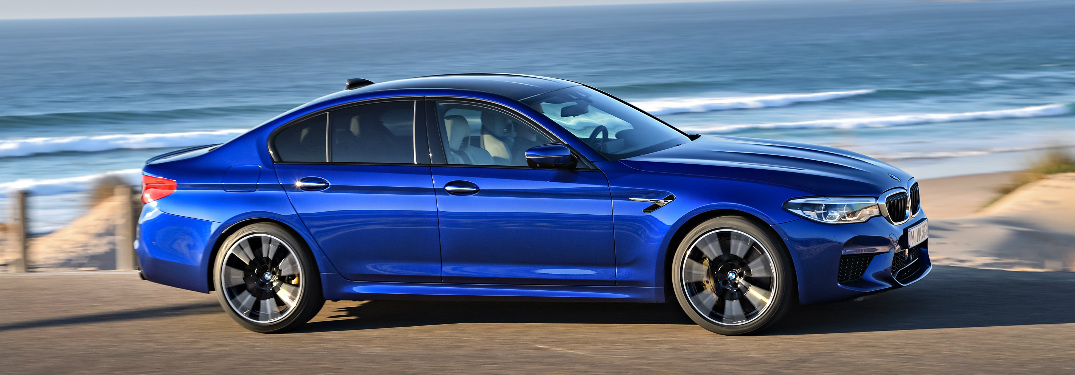 Blue 2018 BMW M5 Parked by the Beach