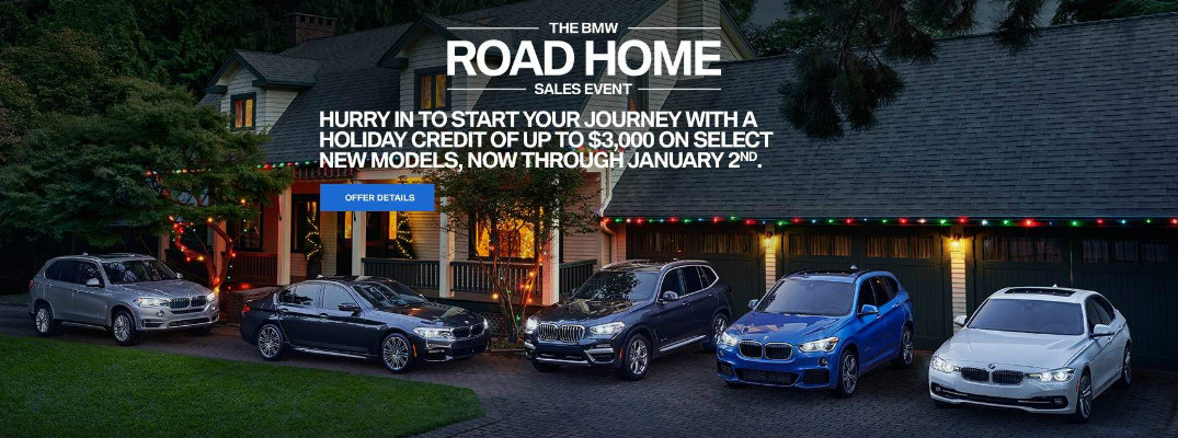 The BMW Road Home Sales Event Title, BMW Models, and House with Christmas Lights