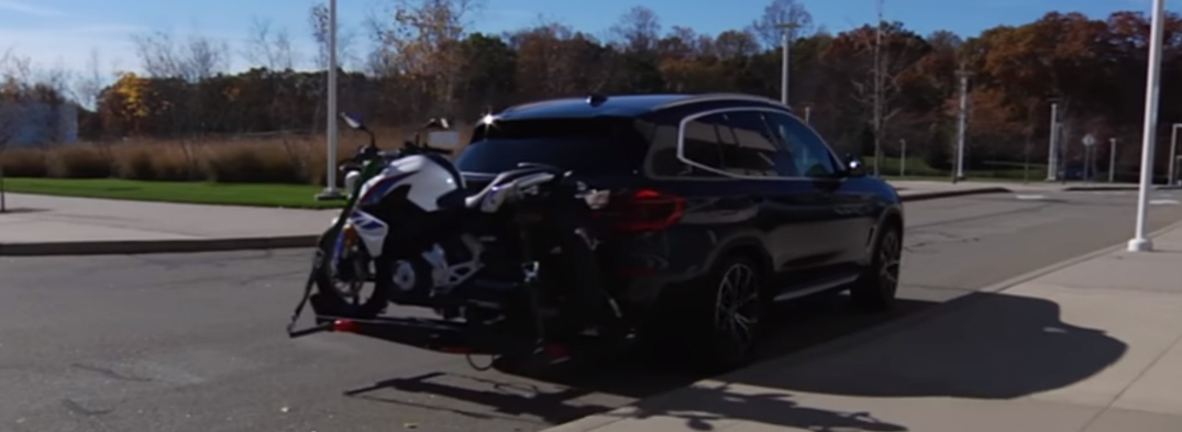 Black 2019 BMW X3 Carrying a Motorcycle