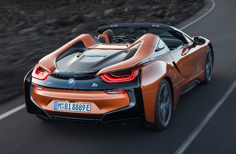 Rear View Of Orange And Black 2019 BMW I8 Roadster
