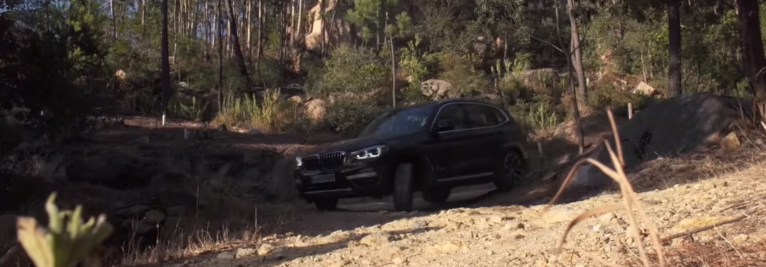 Black BMW SUV Driving on a Rocky Terrain
