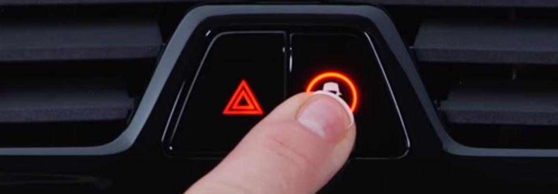 Finger Pressing the BMW Intelligent Safety Button