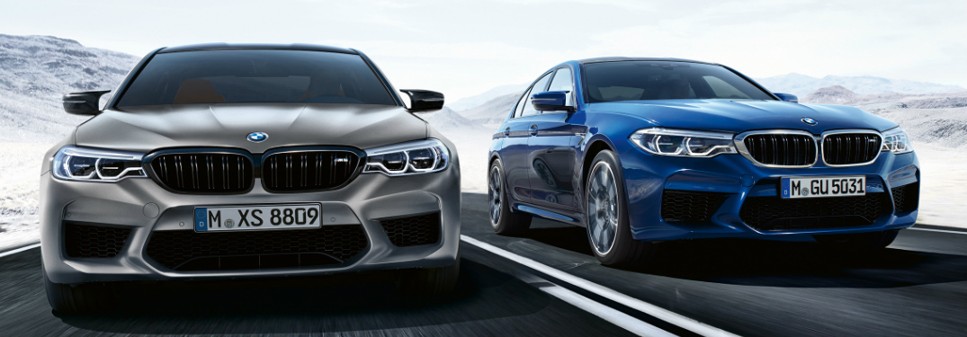 Front View of Two 2019 BMW M5 Competition Sedans Driving Through a Snowy Area