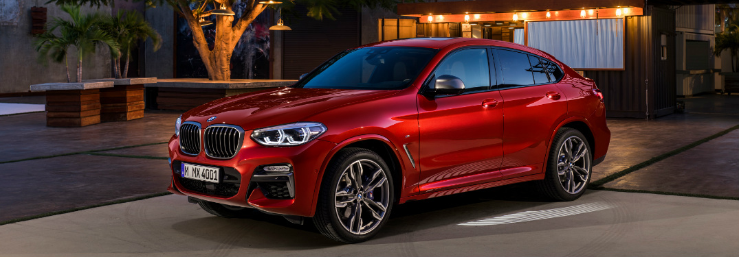 Red 2019 BMW X4 Parked in Front of a House
