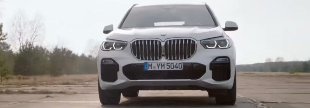 White 2019 BMW X5 Driving on a Barren Road