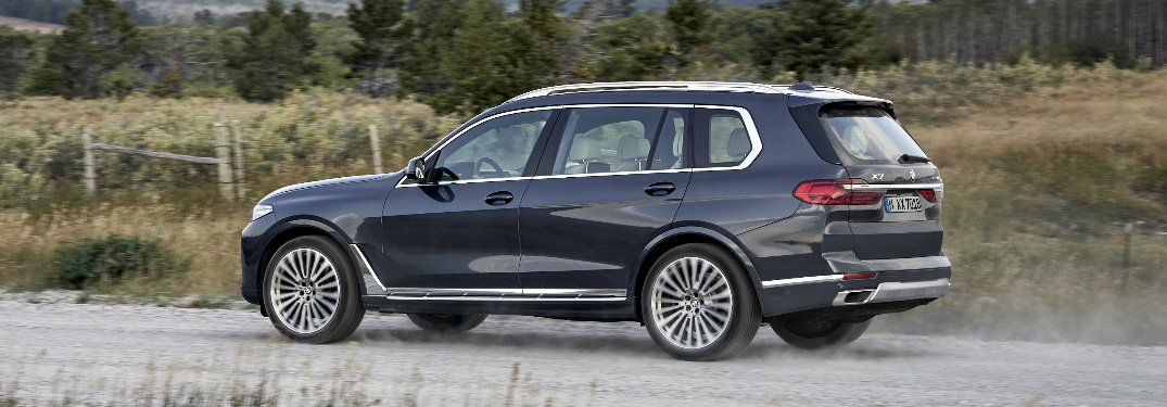 Grey 2019 BMW X7 Driving on a Gravel Road