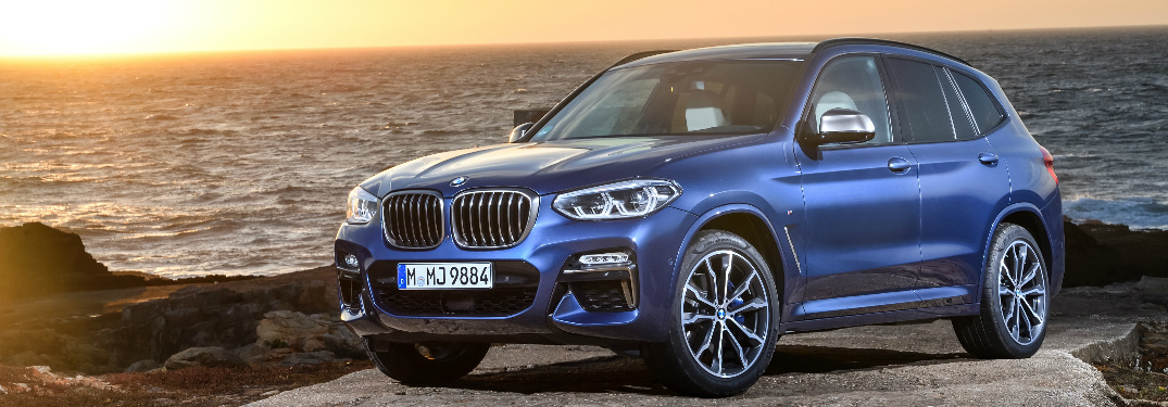 Blue 2018 BMW X3 parked near the ocean