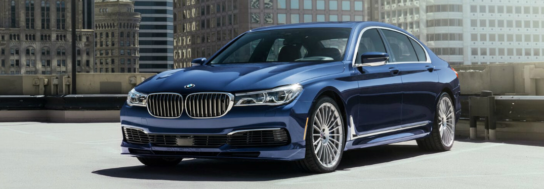 Blue 2019 BMW 7 Series with tall buildings in the background