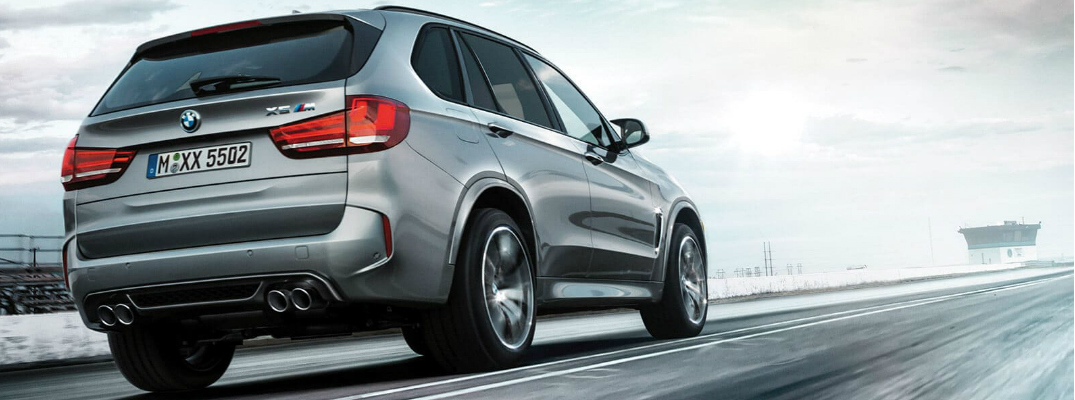 Grey 2019 BMW X5 M driving on a racetrack