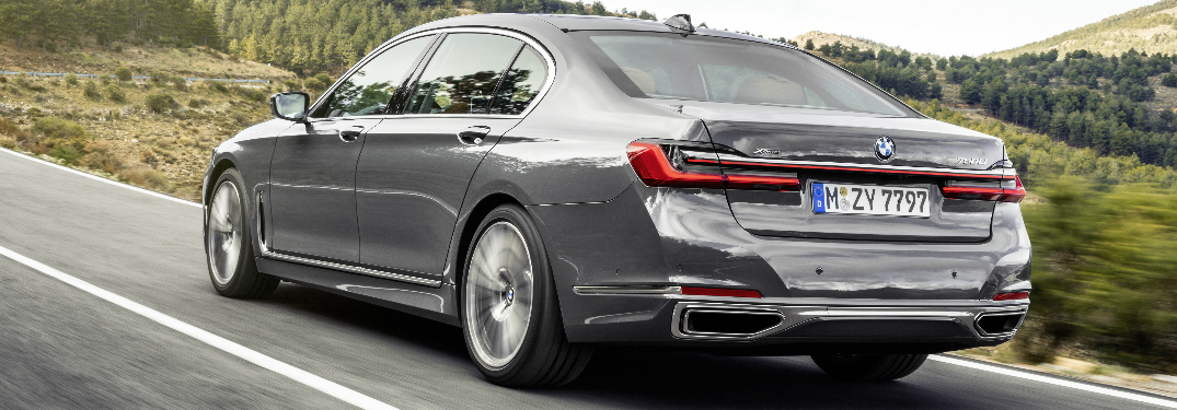 Grey 2020 BMW 7 Series driving by a forest
