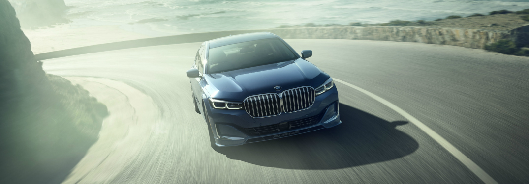 Blue 2020 ALPINA B7 xDrive Sedan driving on a coastal road