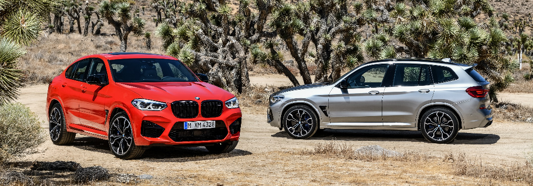 Orange 2020 BMW X4 M, silver 2020 BMW X3 M, and Joshua trees in the background