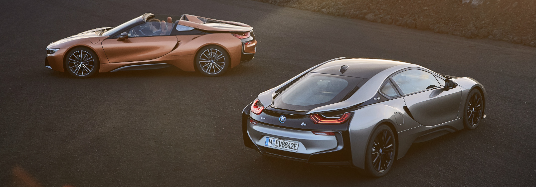 Silver 2019 BMW i8 Coupe and orange 2019 BMW i8 Roadster