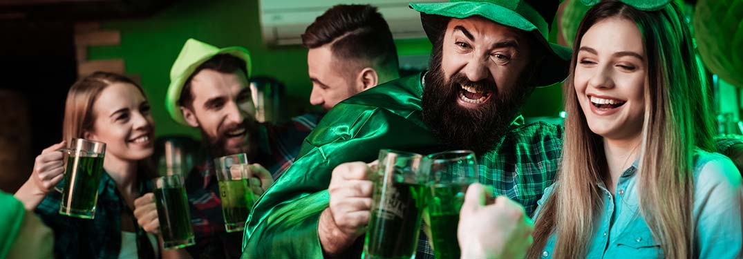 People drinking green beer at a St. Patrick's Day party