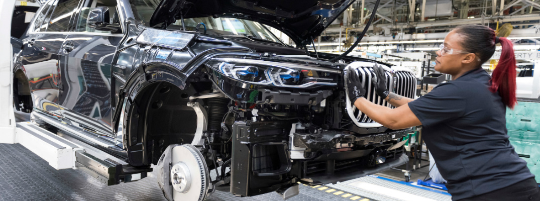 A woman assembling a BMW SUV at Plant Spartanburg