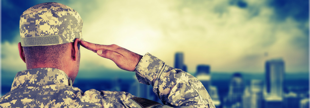american soldier in uniform saluting to skyline of city