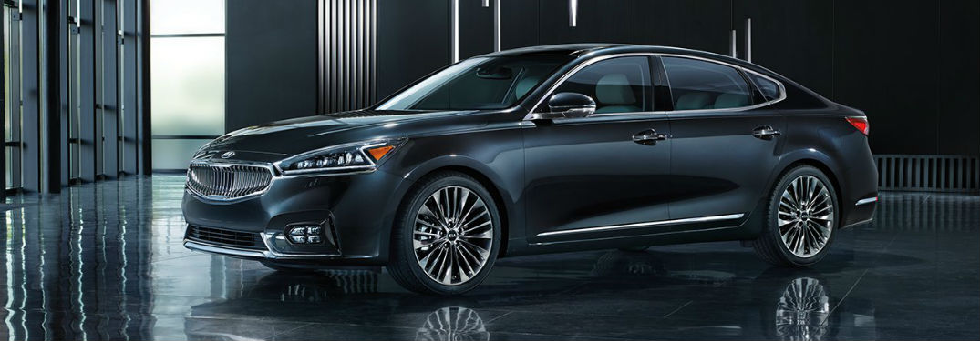 2018 Kia Cadenza Interior and Exterior Color Options with image of a Cadenza parked in a shiny room with gray accents