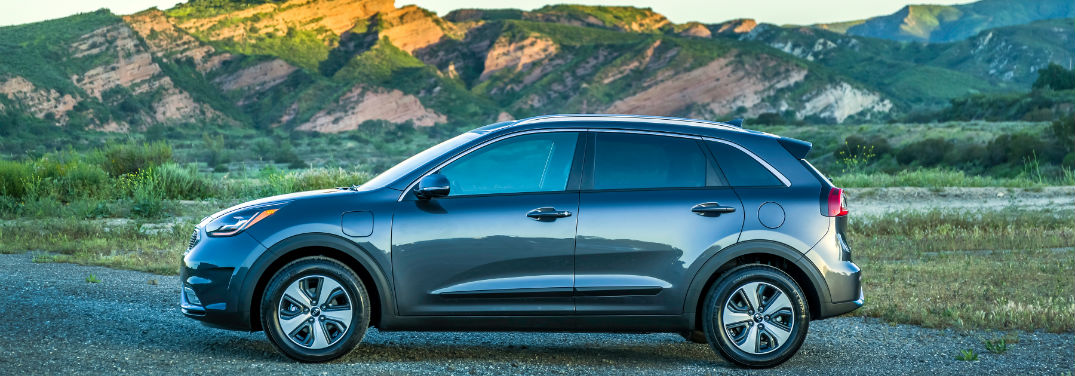 2019 Kia Niro PHEV Pricing and Specifications with image of 2019 NIro PHEV with mountains in the background