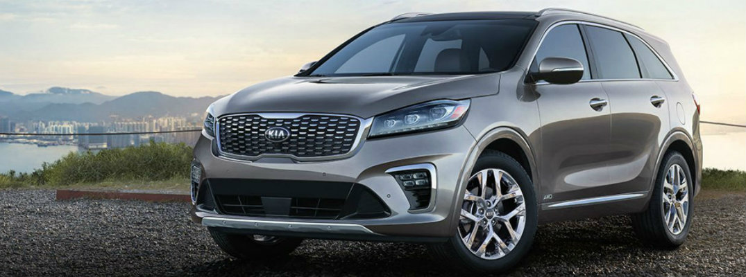 Silver 2019 Kia Sorento parked with sunset in the rear