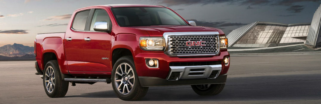 red 2017 GMC Canyon on the road