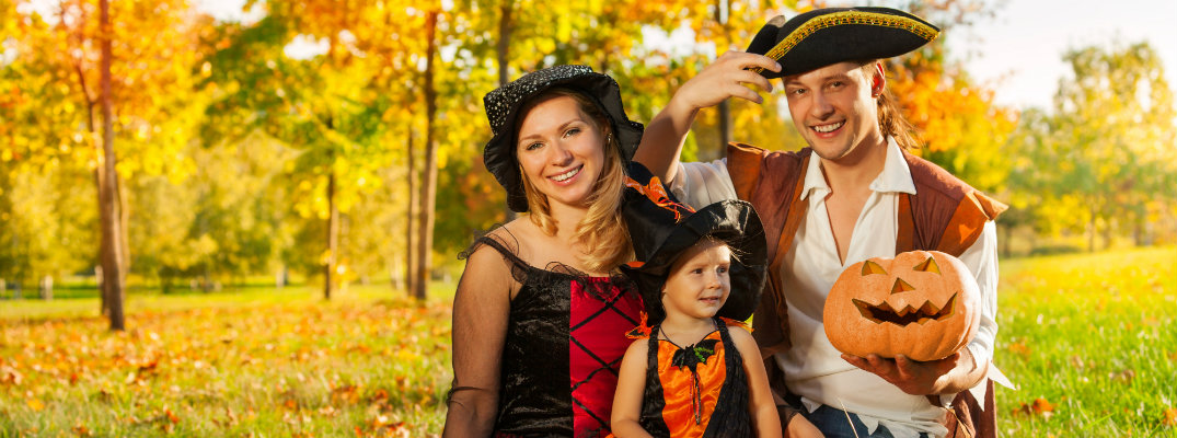 Family wearing Halloween costumes is ready to celebrate the holiday
