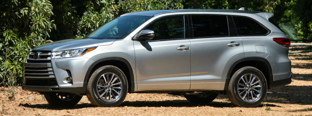 Silver-colored 2018 Toyota Highlander on a rural road