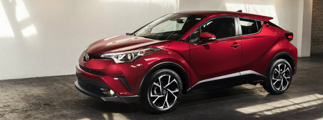 Front/side profile of red 2018 Toyota C-HR