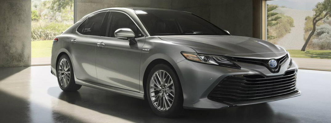 Silver-colored 2018 Toyota Camry parked in a garage