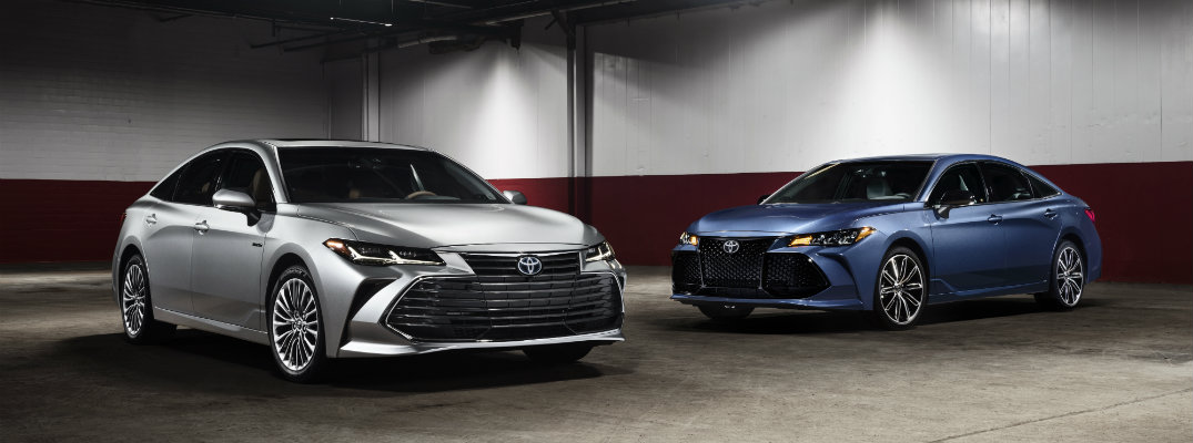 Silver and blue-colored 2019 Toyota Avalon models in a garage