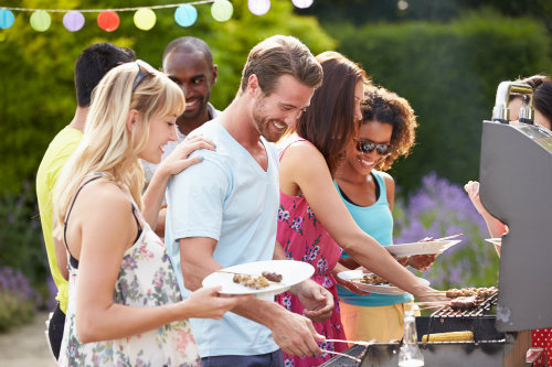 young people celebrating summer at a barbeque