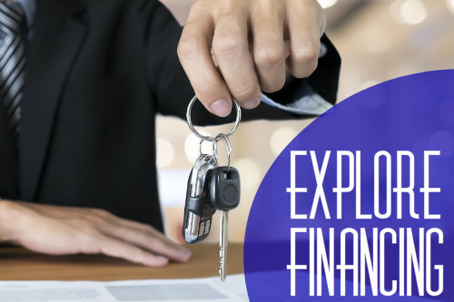 "image that shows a man dangling car keys and the words ""Explore Financing"""