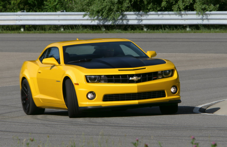 yellow 2013 Chevy Camaro having fun on a race track