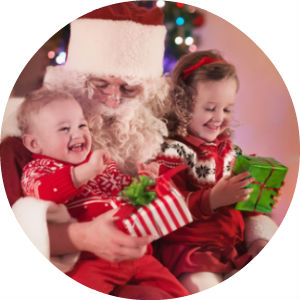 circle image of Santa Claus with two happy children holding presents