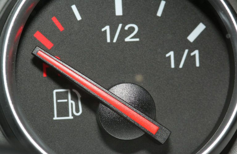 fuel gauge with the indicator in the red at empty