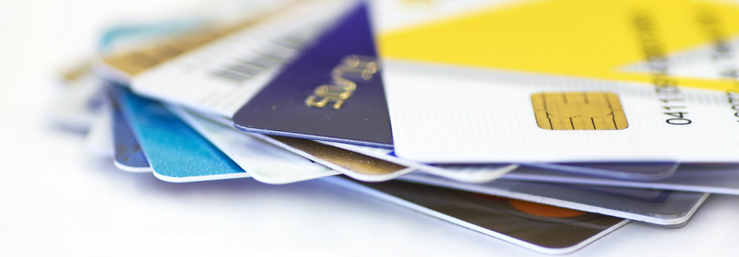 side view of several stacked and fanned-out credit cards