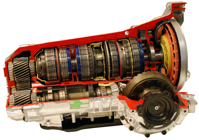 side cutaway view of a car transmission on a white background