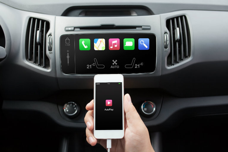 connecting a music or phone device to a car's infotainment system via a cord