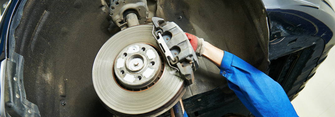 the brake part of a wheel exposed in a car repair shop