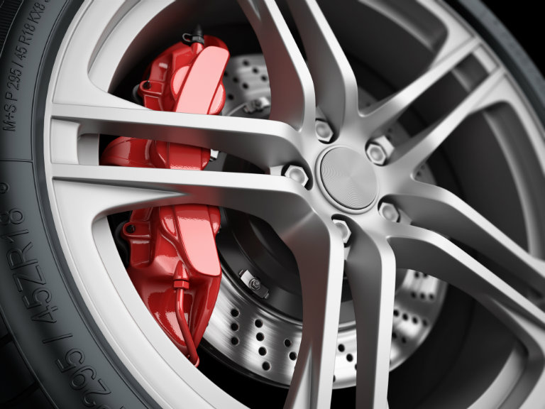 wheel close up with red brake caliper