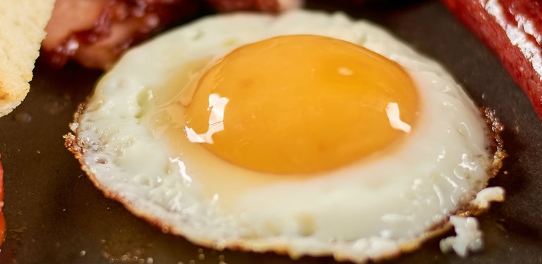 close up view of a frying egg