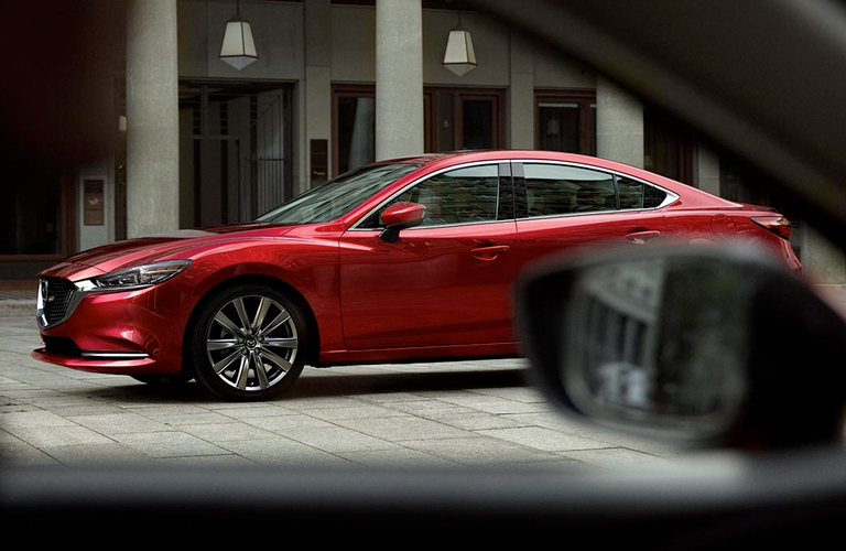 Red 2018 Mazda6 viewed from driver-side window