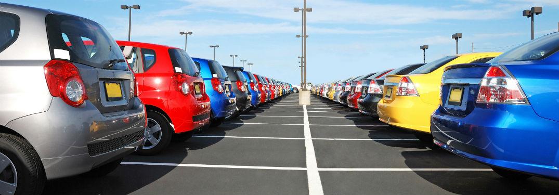 cars in dealership parking lot